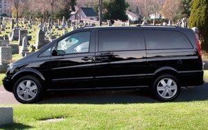 private black car chauffeur car driver with funeral guests in the Mercedes Viano van being driven inside the cemetery to the grave burial site Pinnaroo Valley.